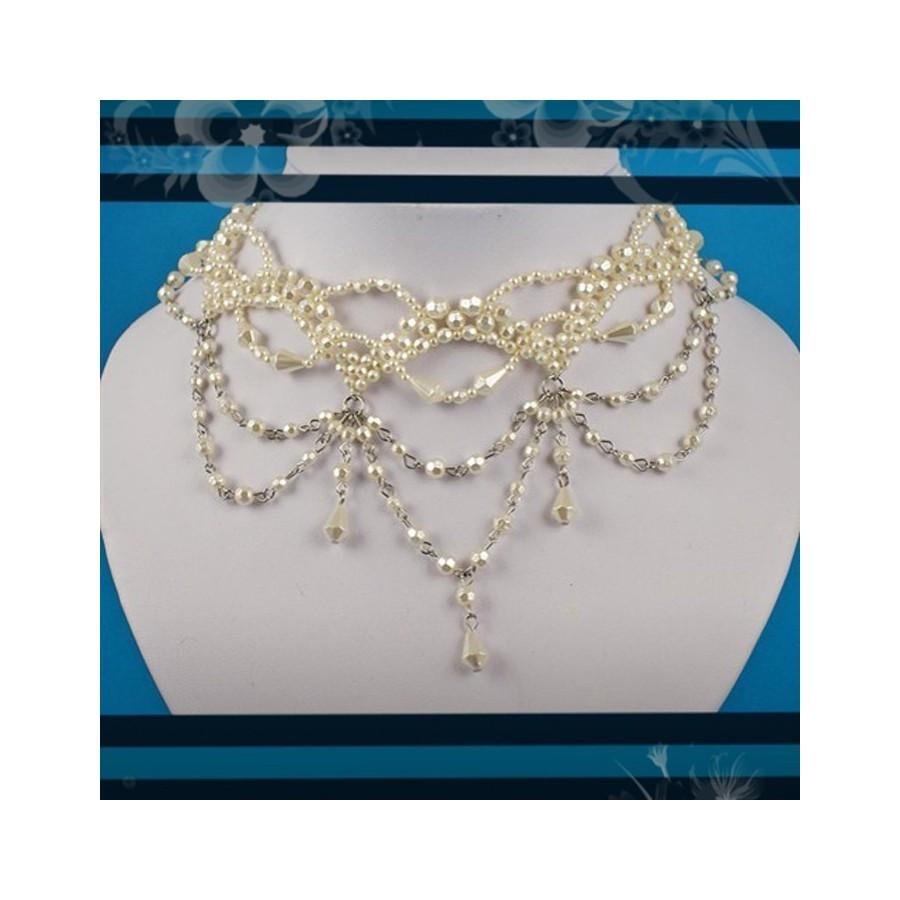 Tour de cou fantaisie avec des perles ivoire